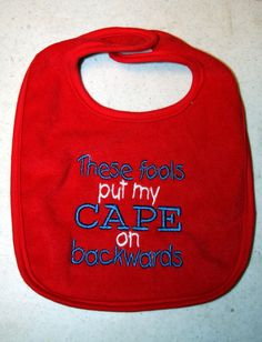 cape bib in red with blue and white writing by KenaKreations, $7.00