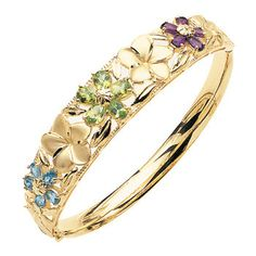 Crafted in 14K yellow gold, this beautiful multi-color stone flower bangle showcases stunning amethyst, perdiot, and blue topaz stones around the