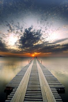 The photographer has used the dock  and the sunset to create a sense of boldness and adding feeling to the photo.