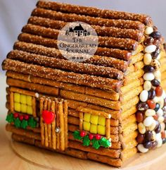 Don't want to make a traditional gingerbread house? Try this Little Cabin in the Woods, a log cabin constructed from a gingerbread house kit, brown royal icing, and pretzels Christmas Goodies, Christmas Desserts, Holiday Treats, Christmas Baking, Christmas Treats, Holiday Recipes, Italian Christmas, Christmas Decor, Christmas Cactus
