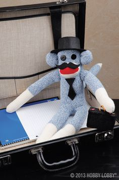 This little guy might be up to monkey business in his cute disguise. He's a basic design that's been decked out in a top hat, a mustache and a teeny-tiny necktie. All accessories are made from stiffened felt, available in the Craft Department.