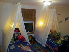 These are the tents I made for the kids by using old tab panel curtains, a pole and eye bolts. Bunk Bed Canopies, Boys Bed Canopy, Kids Bed Tent, Toddler Tent, Bunk Beds Boys, Baby Boy Rooms, Little Girl Rooms, Diy Bed, Kid Decor