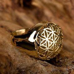 Flower of Life ring gold - The flower of life shape contains a secret shape known as the fruit of life. It consists of 13 spheres that hold many mathematical and geometrical laws. These laws represent the whole universe. Giving the flower of life to someone is like giving them the whole universe in one jewel.