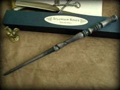 Magic wand in hand carved beech wood: Silver Rosea with