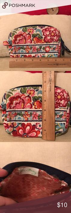 Vera Bradley cosmetic makeup bag Pre-loved VB makeup bag in a pretty floral print.  Red, pink, blue, green, and yellow with navy zipper.  Inside lining is lifting and torn in some areas. Vera Bradley Bags Cosmetic Bags & Cases