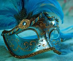 blue Masquerade Masks for Women with feathers | With a beautiful blue mask with a blue feather attached to it