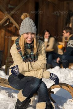 Young woman sitting winter snow sledge cottage ...  20s, activity, adult, at camera, break, cap, caucasian, chalet, cold, cottage, countryside, cozy, day, december, female, friends, group, holiday, hut, leisure, looking, man, mountain, nature, outdoors, outside, people, recreational, relaxation, sitting, smiling, snow, snowy, sunny, tourist, vacation, wearing, winter, wintertime, woman, young