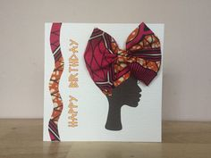 This stunning African print greeting card feature a headwrap tied into an eye catching pretty bow, made using orange and pink African print fabric This beautiful card is blank on the inside, making it suitable for most occasions. It comes in a protective cellophane wrap. Card