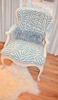 Vintage Chair I found at flea market...painted, distressed, gutted, restuffed, channelled, and dressed with pretty zebra stripes! I like my zebras blue and sassy just like this chair!!! Bam!