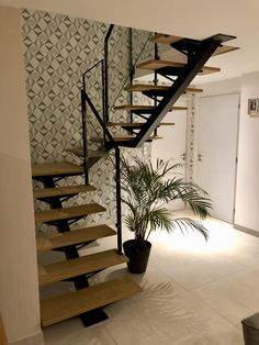 staircase with simple lines, easy access to the rooms located upstairs by .