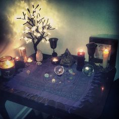 hallowedforest:  Crappy phone pic aside, this is my current altar set up!I'm still in the process of re-arranging and taking things out of storage after the move to get things just right again.
