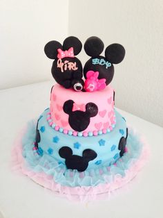 Mickey Mouse and Minnie Mouse gender reveal cake for gender reveal party!