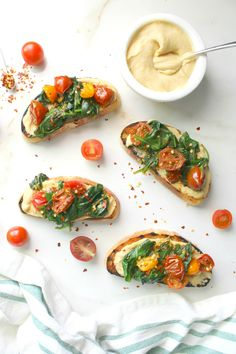 Spruce up breakfast or brunch with this Hummus Toast with Wilted Spinach & Tomatoes. A delicious combination of flavors that will take your toast game to new levels.