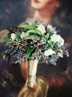 Mostly privet berries with hints of white flowers & finished with gold ribbon.