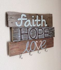 Homemade Wood Key Holder. Add a homemade and rustic touch to your home decor with this painted key holder. Faith, Hope, Love key holder for a warming home. #HomemadeHouseDecorations,