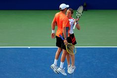 Kim Clijsters (BEL) and her partner Bob Bryan (USA) react after defeating Irina Falcon (USA) and Steve Johnson (USA) at the 2012 US Open. - Getty Images