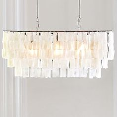 Shop large rectangle hanging capiz pendant - white from west elm. Find a wide selection of furniture and decor options that will suit your tastes, including a variety of large rectangle hanging capiz pendant - white. West Elm Chandelier, White Chandelier, Rectangle Chandelier, Chandelier Pendant Lights, Dining Chandelier, Pendant Lamp, Shell Pendant, Dining Pendant, Light Pendant
