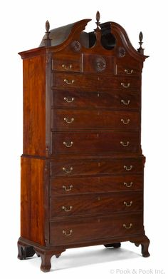 "Pook & Pook.  April 25th 2014.  Lot 4.    Connecticut Chippendale cherry bonnet top chest on chest, ca. 1775, probably Colchester, with a pinwheel carved tympanum & drawer, 89"" h., 41 3/4"" w. Estimated: $8K - $12K."