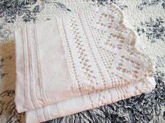 This pair of pillowcases are of crisp white cotton with rows of tucks and an elaborate crocheted lace trim  100% cotton.