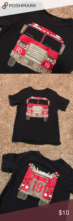 Boys Firetruck Tshirt Cute boys firetruck shirt from Gap. Firetruck detail on front of shirt that shows the back of a fire truck on the backside. Firetruck graphic looks brand new - fabric is only slightly faded on the bottom. Bundle with my other items and save 💰💰💰with bundle discount. GAP Shirts & Tops Tees - Short Sleeve