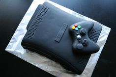 Xbox cake  I'm thinking this would be an awesome cake for my nephew's 13th birthday but there isn't a bakery around here that can do this within my budget.