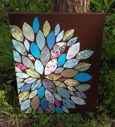 20 ways to Mod Podge a canvas - including this paper pieced flower