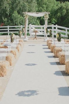 rustic wedding arch & hay bales wedding seating