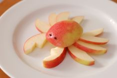 Slice a 1cm piece off one side for the head. Slice a thicker one off the other side of the apple.Cut this piece in half (along core line). Slice each half into 4 legs. Cut off one of the remaining sides, should be about 2cm thick. Cut out V shapes. Slice down the middle to create the claws. Gauge to holes where the eyes are and slot in two apples seeds. Yum!