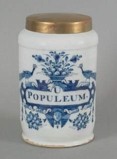 Delft blue and white drug jar, ca. 1730, with a large cartouche surrounded by peacocks and floral swags, inscribed U Populeum, signed Johannes Pennis, 10 1/2'' h.