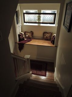 """Romance of the """"window seat"""".  WJM designed feature insulated glass with antique stained glass that filters daylight with night lights placed outside to bathe the scene in soft evening light.  The turn of the stair becomes is a beautiful moment with each pass ..."""