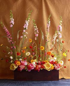Love this casual, yet elegant flower arrangement!