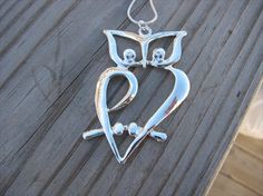 silver owl necklace...gives me ideas for a possible owl tattoo design. hmmmmm