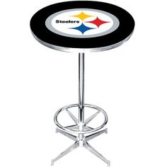 Add some NFL pride to any man cave, bar, rec room, or game room with this NFL pub table. Adorned with the team logo of your favorite professional football team, this pub table is both durable and easy to assemble. A must have for any NFL fan. Nfl Green Bay, Green Bay Packers, Wood And Metal, Solid Wood, Metal Solid, Counter Height Pub Table, Breakfast Nook Dining Set, Pub Table Sets, Dining Table In Kitchen