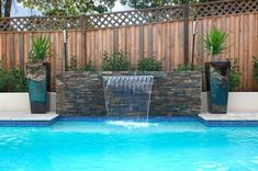 similar to our fenceline. But would have to be at the pool edge. Pool cover wouldn't cover the seat. one waterfall with planters on side. but might want more contemporary/modern cement planters on side. matching the firepit? but not as long Provence, Backyard Pool Landscaping, Landscaping Ideas, Landscaping Company, Patio Ideas, Kidney Shaped Pool, Pool Landscape Design, Pool Water Features, Modern Pools