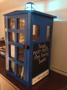 "Bigger on the inside, this is the Little Free Library of the University of Texas at Austin's School of Information. It is a gift from the Fall 2013 ""Information in a Social and Cultural Context"" class (6-9 on Thursdays, Baby!). We hope you enjoy!"