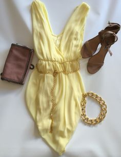 Shop Lalabloom: www.lalabloom.com/collections/lala-bloom-dresses/products/stunning-yellow-mini-dress