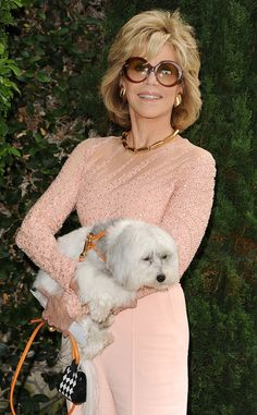 Jane Fonda totally turned heads in a sparkly pink get-up, topped off with statement oversized round sunnies, at an event with her pup!