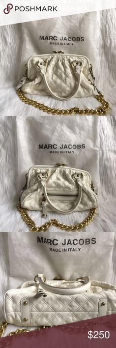Marc Jacobs Stardust Stam White Leather Handbag authentic marc jacobs white quilted leather stardust stam purse. very rare, i haven't seen another in this size available for sale. such a stunning item. crafted of soft orchid petal white leather. has a detachable gold chain strap. features rolled leather handles, a back zipper pocket, and gold hardware. the gold kiss lock closure opens to a brown suede interior with one cell phone pocket and one zipper pocket pouch. *CONTINUES IN COMMENTS…
