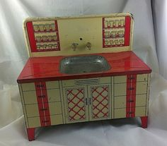 Vintage Wolverine Sink Litho Tin Toy