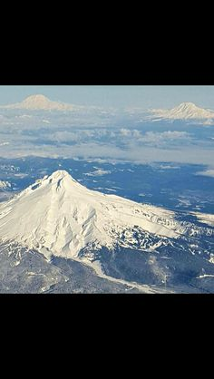 Mt. Hood, Mt. Rainer and Mt. Adams as seen from a plane