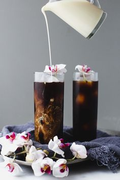 Make This Easy Cardamom Cold Brew Vietnamese Coffee ASAP | This is how you turn the volume up on regular iced coffee. After 24 hours you can strain the coffee through a colander lined with a double layer of cheesecloth into a pitcher. To make the vanilla cream, simply pour some sweetened condensed milk, half-and-half, and vanilla extract in a Mason jar and shake it up. When you're ready to serve the coffee, pour the cold brew concentrate into ice-filled glasses, and top with the vanilla…