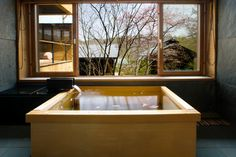 Hoshinoya - Japanese bamboo bathtub (Sakura Season) Wood can be any size you need, so it can fit into whatever space you have in your tiny bathroom. You would need a really good craftsman to build a watertight bamboo tub, though.