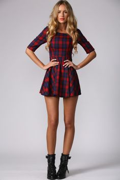 Add a little bit of old school cool to your look with our Tartan Prep Dress. This cute fit and flare style dress has 3/4 tshirt style sleeve and a drop waist detail. With a round neckline, this dress also has an invisible back zip and flirty skirt. We love teaming it back with a leather jacket, a pair of suede ankle booties and an oversized scarf for those chilly mornings! Dress. Not lined. Cold hand wash only. Model is standard XS and is wearing XS. This dress runs small, please go one…
