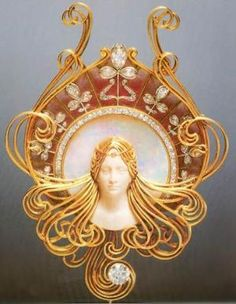 French designer, Rene Lalique, (1860-1945) ornate jewelry.  This example of his work, was fashioned for French actress, Sarah Bernhardt, (1844-1923). Who was a very famous stage actress, during the Belle Epoche in France, and graced the American stage as well, during the Gilded Age. Lalique created many ornate jewelry pieces that Bernhardt also wore as part of her stage costumes.