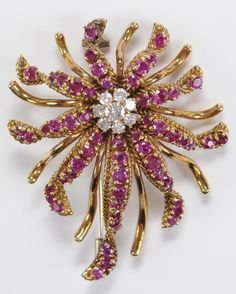 "July 31st #Auction for this amazing #Vintage 18 Karat #Yellow #Gold #Ruby and #Diamond Brooch set with eight round brilliant diamonds, estimated weight 0.40 carats, and 65 round faceted genuine #rubies, estimated weight 2.50 carats, stamped ""18K"", 2 x 1-1/2 in., 21 grams light wear.  Estimate: $600 - $900 @Brunk"