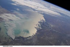 https://flic.kr/p/8EvcNt | Smoke Plume, Caspian Sea, Kazakhstan (NASA, International Space Station Science, 09/11/10) | A smoke plume near the northern Caspian Sea, Kazakhstan is featured in this image photographed by an Expedition 24 crew member on the International Space Station. This broad view of the north coast of the Caspian Sea shows a smoke plume (left) and two river deltas (bottom and lower right). The larger delta is that of the Volga River which appears prominently here in…