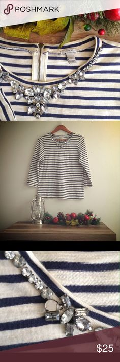 J Crew Jeweled Stripped Sweater J Crew Jeweled Stripped Sweater with medium arm length.navy blue stripes and white/cream color. Missing one jewel (refer to picture). Good Condition! 100% Cotton  'Tis the season to make an offer. Indeed it 'tis J. Crew Tops