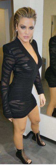 Who made Khloe Kardashian's lace up shoes and black long sleeve tiger print dress?