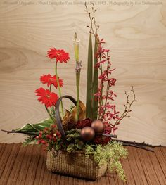As seen in the November 2013 issue of Flowers& magazine, this non-traditional seasonal design would be the perfect decor piece on a hall or dining table. Featuring permanent botanical succulents, pine and hypericum berries, mixed with fresh gerberas and orchids (of course you could use silk for these too if you wanted to!) *Posted with permission from Flowers& magazine. Design by Tom Bowling AIFD, PFCI. Photography by Ron Decapheron.