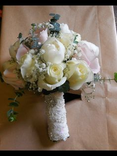Hand tied posy of white peony, ivory norma Jean rose, dusky pink secret garden rose, pale pink sweet avalanche rose, ivory majolica spray roses with gyp and eucalyptus, finished in pearl lace and a crystal broach. Lovingly made by Karen @finnese floral designs